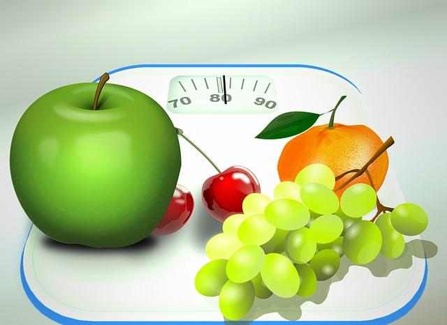 obrázek jablko, víno, mandarinka a třešeň na váze
